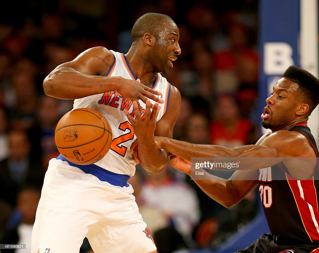 <a gi-track='captionPersonalityLinkClicked' href=/galleries/search?phrase=Raymond+Felton&family=editorial&specificpeople=209141 ng-click='$event.stopPropagation()'>Raymond Felton</a> #2 of the New York Knicks loses the ball as <a gi-track='captionPersonalityLinkClicked' href=/galleries/search?phrase=Norris+Cole&family=editorial&specificpeople=5770147 ng-click='$event.stopPropagation()'>Norris Cole</a> #30 of the Miami Heat defends at Madison Square Garden on January 9, 2014 in New York City.