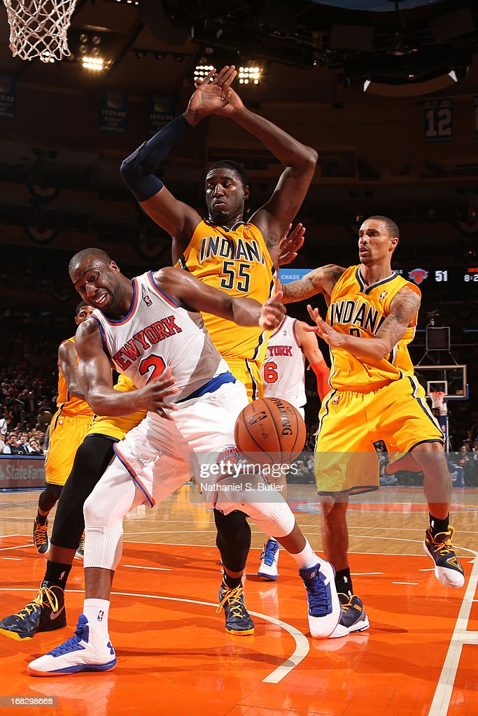 Raymond Felton #2 of the New York Knicks makes a pass against Roy Hibbert #55 of the Indiana Pacers in Game Two of the Eastern Conference Semifinals during the 2013 NBA Playoffs on May 7, 2013 at Madison Square Garden in New York City.