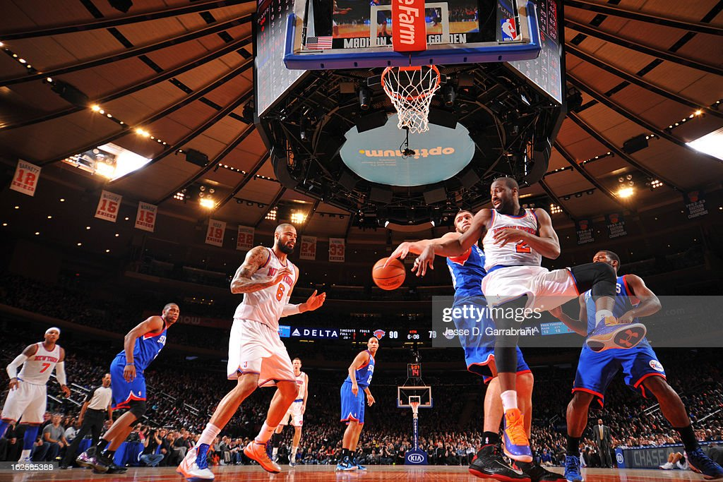 <a gi-track='captionPersonalityLinkClicked' href=/galleries/search?phrase=Raymond+Felton&family=editorial&specificpeople=209141 ng-click='$event.stopPropagation()'>Raymond Felton</a> #2 of the New York Knicks passes the ball to teammate <a gi-track='captionPersonalityLinkClicked' href=/galleries/search?phrase=Tyson+Chandler&family=editorial&specificpeople=202061 ng-click='$event.stopPropagation()'>Tyson Chandler</a> #6 against <a gi-track='captionPersonalityLinkClicked' href=/galleries/search?phrase=Spencer+Hawes&family=editorial&specificpeople=3848319 ng-click='$event.stopPropagation()'>Spencer Hawes</a> #00 of the Philadelphia 76ers on February 24, 2013 at Madison Square Garden in New York City, New York.