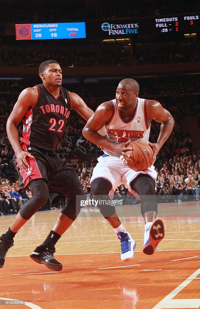Raymond Felton #2 of the New York Knicks protects the ball from Rudy Gay #22 of the Toronto Raptors on February 13, 2013 at Madison Square Garden in New York City.
