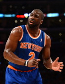 Raymond Felton of the New York Knicks reacts to a Knick foul against the Los Angeles Lakers at Staples Center on March 25 2014 in Los Angeles...