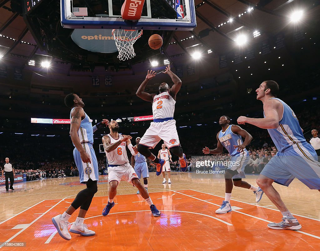 Raymond Felton #2 of the New York Knicks scores two against the Denver Nuggets at Madison Square Garden on December 9, 2012 in New York City.