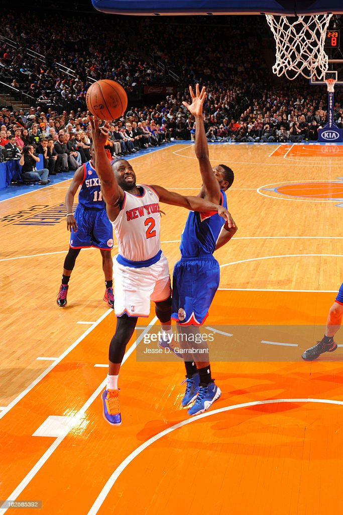 <a gi-track='captionPersonalityLinkClicked' href=/galleries/search?phrase=Raymond+Felton&family=editorial&specificpeople=209141 ng-click='$event.stopPropagation()'>Raymond Felton</a> #2 of the New York Knicks shoots a layup against <a gi-track='captionPersonalityLinkClicked' href=/galleries/search?phrase=Jeremy+Pargo&family=editorial&specificpeople=732443 ng-click='$event.stopPropagation()'>Jeremy Pargo</a> #0 of the Philadelphia 76ers on February 24, 2013 at Madison Square Garden in New York City, New York.