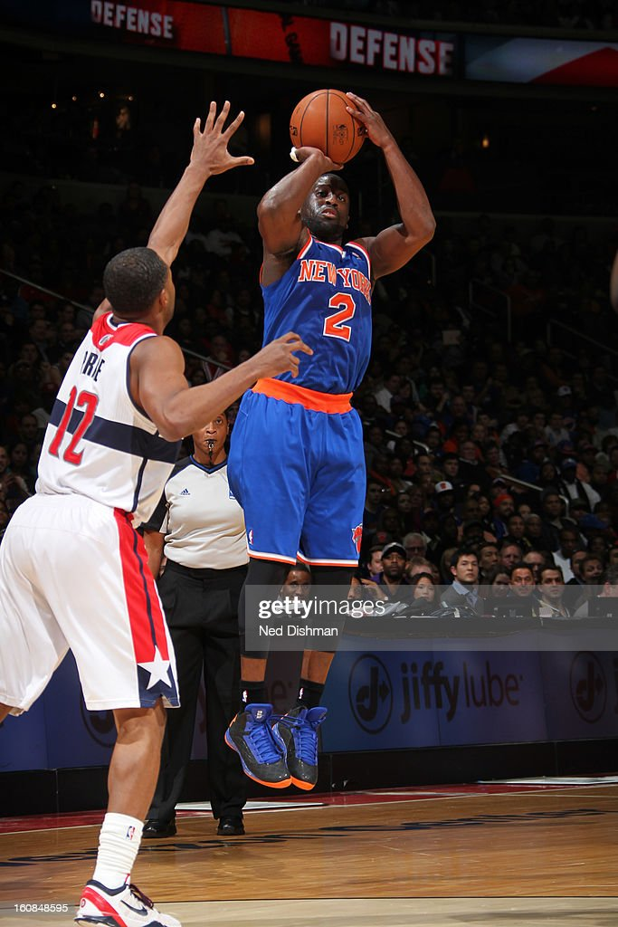 <a gi-track='captionPersonalityLinkClicked' href=/galleries/search?phrase=Raymond+Felton&family=editorial&specificpeople=209141 ng-click='$event.stopPropagation()'>Raymond Felton</a> #2 of the New York Knicks shoots against A.J. Price #12 of the Washington Wizards during the game at the Verizon Center on February 6, 2013 in Washington, DC.