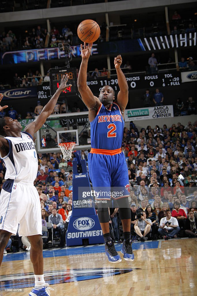 Raymond Felton #2 of the New York Knicks shoots against Darren Collison #4 of the Dallas Mavericks on November 21, 2012 at the American Airlines Center in Dallas, Texas.
