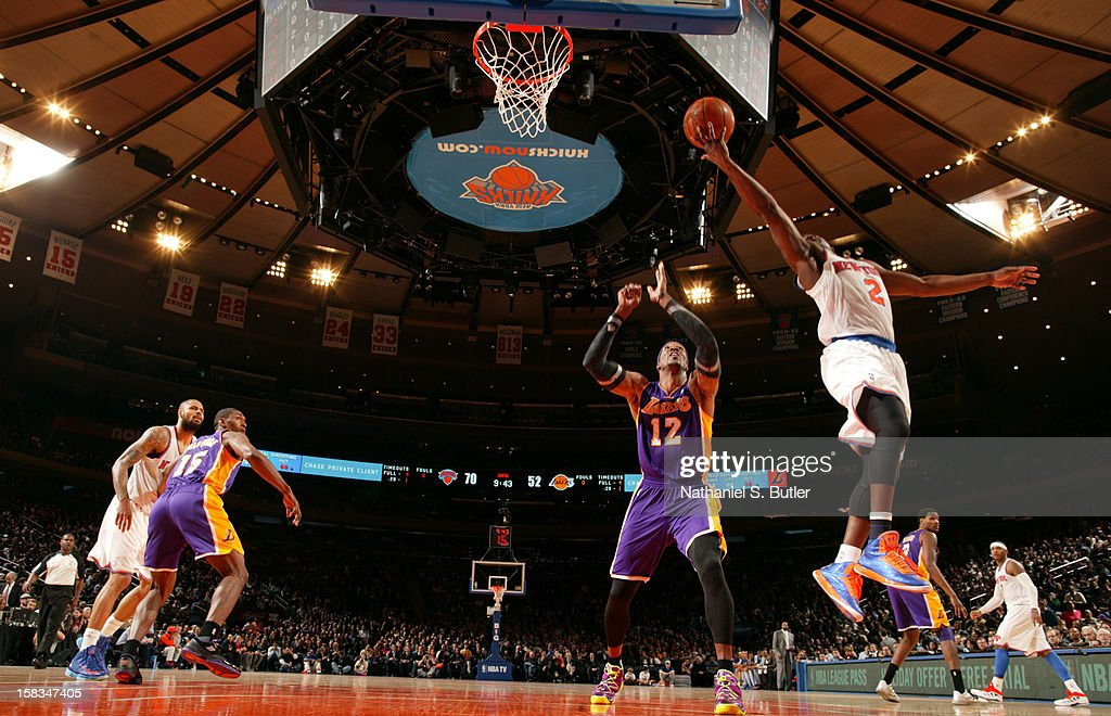 Raymond Felton #2 of the New York Knicks shoots against Dwight Howard #12 of the Los Angeles Lakers on December 13, 2012 at Madison Square Garden in New York City.