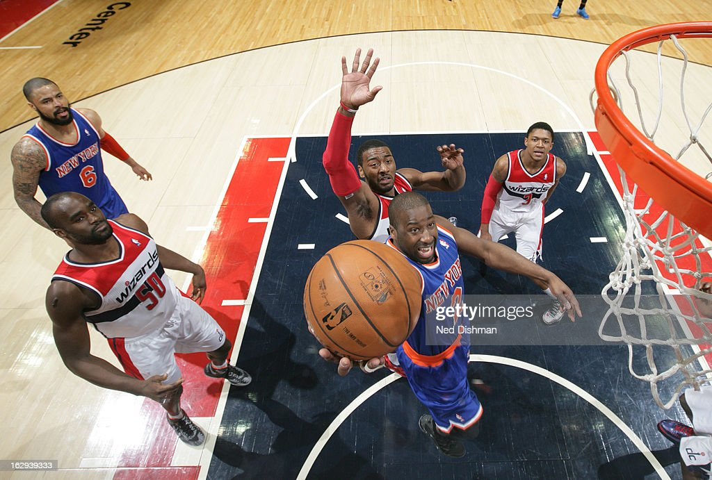 Raymond Felton #2 of the New York Knicks shoots against John Wall #2 of the Washington Wizards during the game at the Verizon Center on March 1, 2013 in Washington, DC.