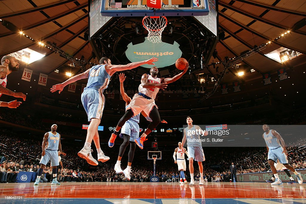 Raymond Felton #2 of the New York Knicks shoots against Kosta Koufos #41 of the Denver Nuggets on December 9, 2012 at Madison Square Garden in New York City.