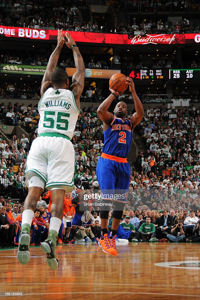 <a gi-track='captionPersonalityLinkClicked' href=/galleries/search?phrase=Raymond+Felton&family=editorial&specificpeople=209141 ng-click='$event.stopPropagation()'>Raymond Felton</a> #2 of the New York Knicks shoots against <a gi-track='captionPersonalityLinkClicked' href=/galleries/search?phrase=Terrence+Williams&family=editorial&specificpeople=666450 ng-click='$event.stopPropagation()'>Terrence Williams</a> #55 of the Boston Celtics in Game Six of the Eastern Conference Quarterfinals during the NBA Playoffs on May 3, 2013 at the TD Garden in Boston, Massachusetts.