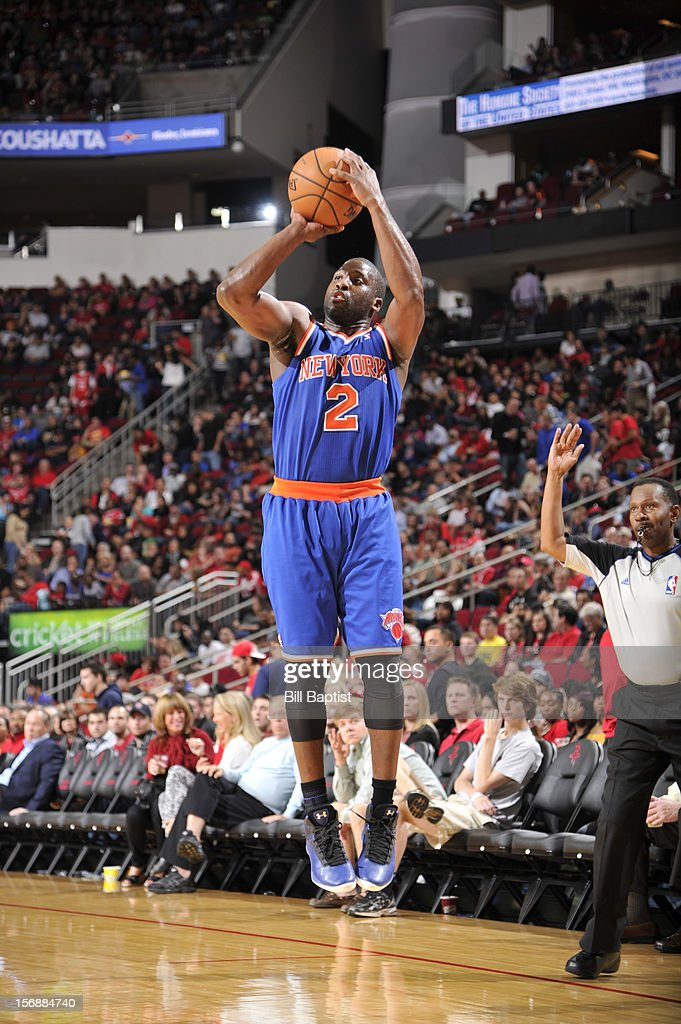 <a gi-track='captionPersonalityLinkClicked' href=/galleries/search?phrase=Raymond+Felton&family=editorial&specificpeople=209141 ng-click='$event.stopPropagation()'>Raymond Felton</a> #2 of the New York Knicks shoots the ball against the Houston Rockets on November 23, 2012 at the Toyota Center in Houston, Texas.