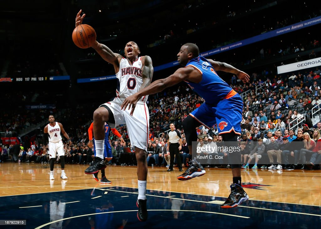 <a gi-track='captionPersonalityLinkClicked' href=/galleries/search?phrase=Raymond+Felton&family=editorial&specificpeople=209141 ng-click='$event.stopPropagation()'>Raymond Felton</a> #2 of the New York Knicks strips the ball from <a gi-track='captionPersonalityLinkClicked' href=/galleries/search?phrase=Jeff+Teague&family=editorial&specificpeople=4680498 ng-click='$event.stopPropagation()'>Jeff Teague</a> #0 of the Atlanta Hawks at Philips Arena on November 13, 2013 in Atlanta, Georgia.