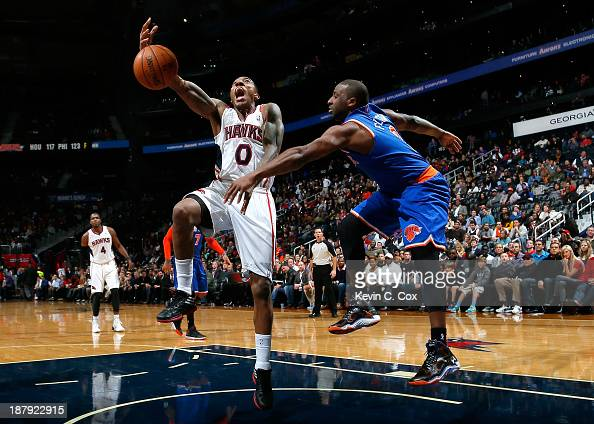 Raymond Felton of the New York Knicks strips the ball from Jeff Teague of the Atlanta Hawks at Philips Arena on November 13 2013 in Atlanta Georgia...