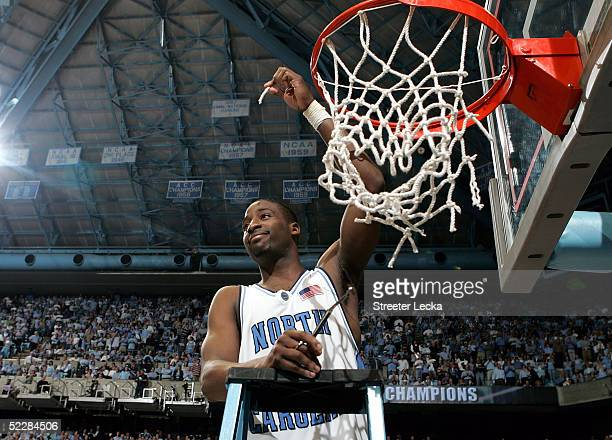 Raymond Felton of the North Carolina Tar Heels cuts down the net after the victory over the Duke Blue Devils on March 6 2005 at the Dean E Smith...