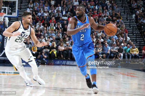 Raymond Felton of the Oklahoma City Thunder handles the ball against Raul Neto of the Utah Jazz during the game on October 21 2017 at vivintSmartHome...