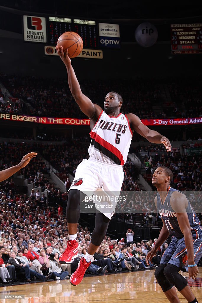 <a gi-track='captionPersonalityLinkClicked' href=/galleries/search?phrase=Raymond+Felton&family=editorial&specificpeople=209141 ng-click='$event.stopPropagation()'>Raymond Felton</a> #5 of the Portland Trail Blazers goes to the basket against Cory Higgins #11 of the Charlotte Bobcats on February 1, 2012 at the Rose Garden Arena in Portland, Oregon.