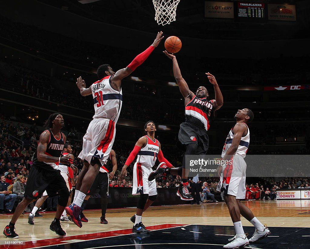 <a gi-track='captionPersonalityLinkClicked' href=/galleries/search?phrase=Raymond+Felton&family=editorial&specificpeople=209141 ng-click='$event.stopPropagation()'>Raymond Felton</a> #5 of the Portland Trail Blazers goes to the basket against <a gi-track='captionPersonalityLinkClicked' href=/galleries/search?phrase=Chris+Singleton&family=editorial&specificpeople=241555 ng-click='$event.stopPropagation()'>Chris Singleton</a> #31 of the Washington Wizards at the Verizon Center on March 10, 2012 in Washington, DC.