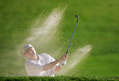 Raymond Floyd hits his second shot out of a sandtrap on the 8th hole during the first round of the Senior PGA Championship on May 26 2005 at Laurel...