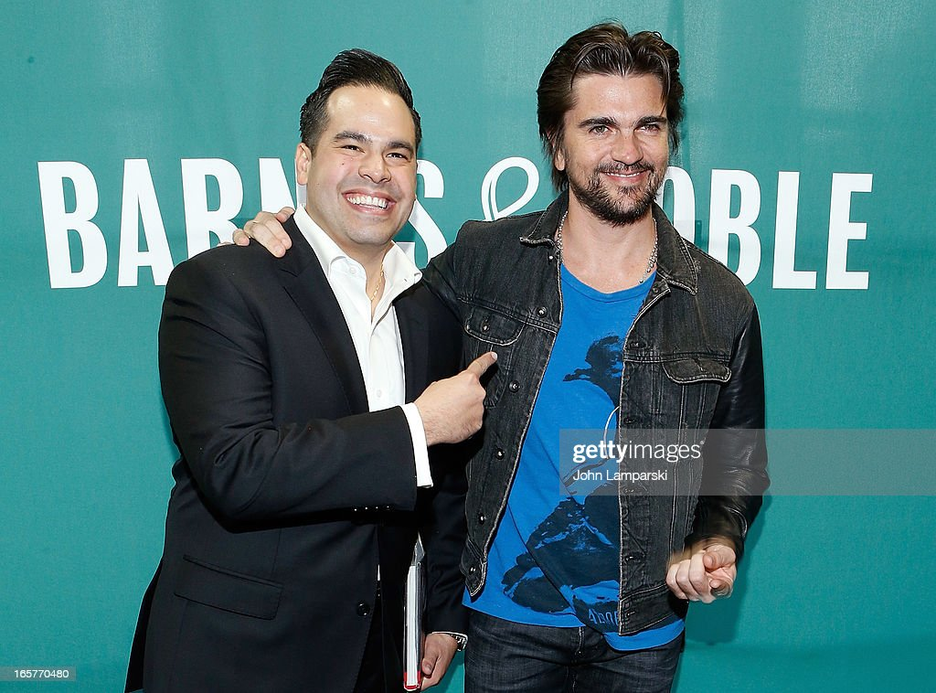 Raymond Garcia and <a gi-track='captionPersonalityLinkClicked' href=/galleries/search?phrase=Juanes&family=editorial&specificpeople=202467 ng-click='$event.stopPropagation()'>Juanes</a> promote 'Chasing The Sun' at Barnes & Noble Union Square on April 5, 2013 in New York City.