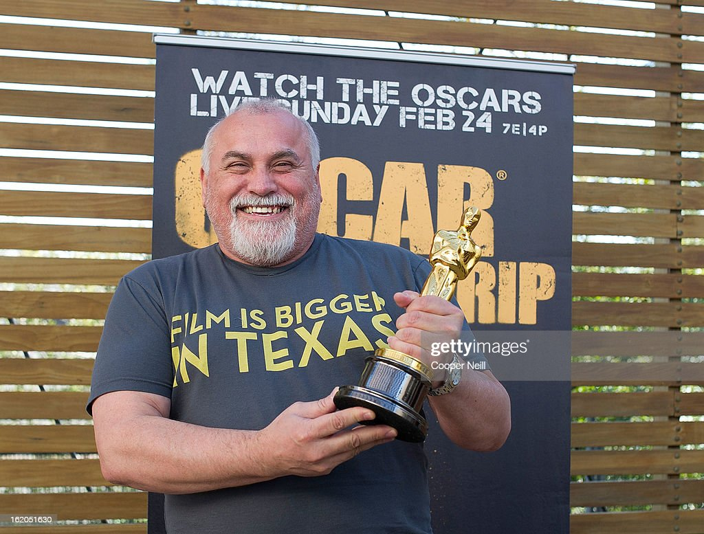 Raymond Garcia poses with an Oscar trophey during First-Ever Oscar Roadtrip at the Angelika Film Center on February 18, 2013 in Dallas.