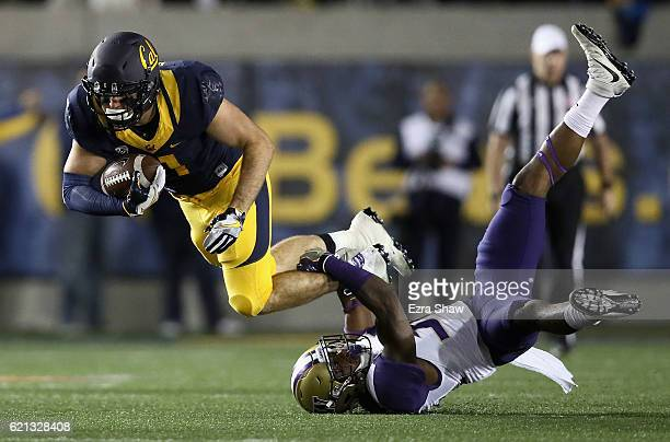Raymond Hudson of the California Golden Bears is tackled by Budda Baker of the Washington Huskies at California Memorial Stadium on November 5 2016...