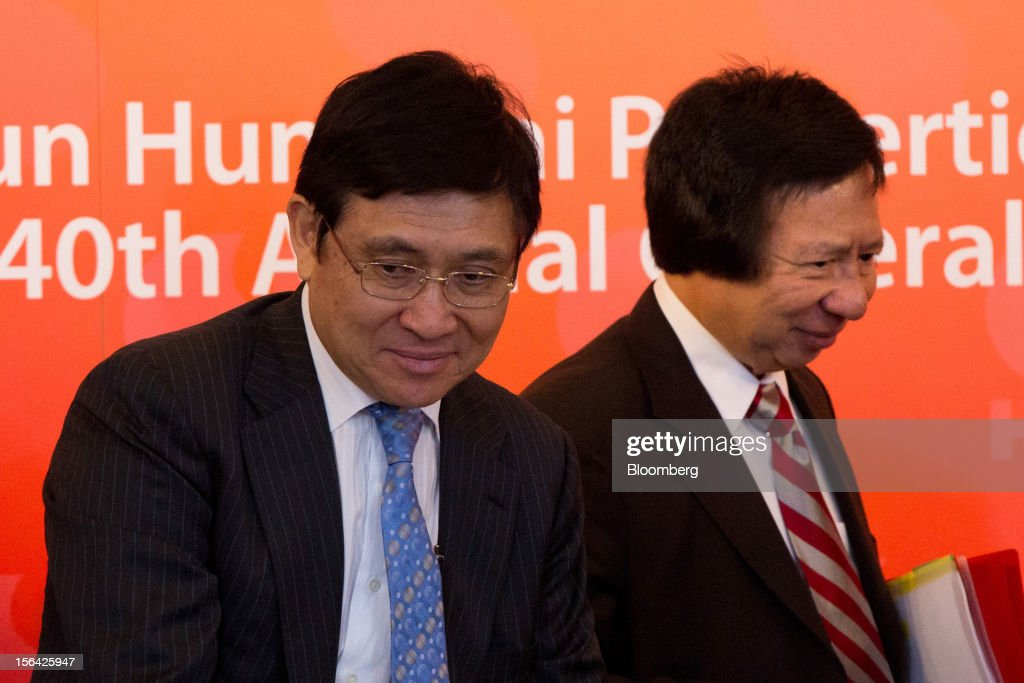 Raymond Kwok, co-chairman of Sun Hung Kai Properties Ltd., left, and Thomas Kwok, co-chairman, stand at the end of a news conference in Hong Kong, China, on Thursday, Nov. 15, 2012. Sun Hung Kai will continue buying land in Hong Kong, says Thomas Kwok. Photographer: Lam Yik Fei/Bloomberg via Getty Images