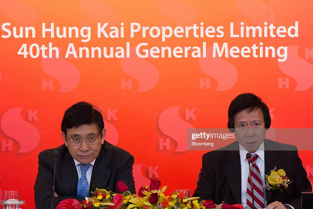 Raymond Kwok, co-chairman of Sun Hung Kai Properties Ltd., left, listens while Thomas Kwok, co-chairman, speaks during a news conference in Hong Kong, China, on Thursday, Nov. 15, 2012. Sun Hung Kai will continue buying land in Hong Kong, says Thomas Kwok. Photographer: Lam Yik Fei/Bloomberg via Getty Images