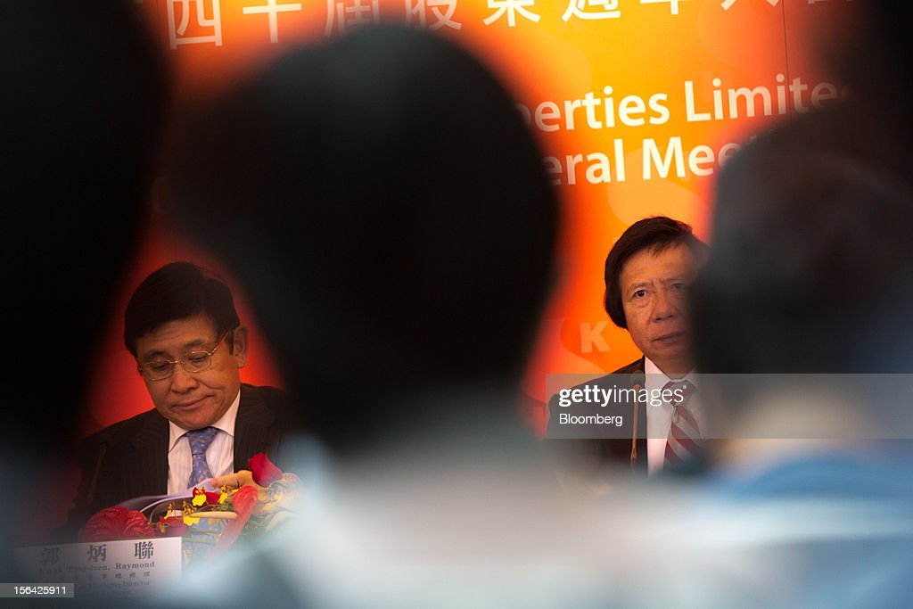 Raymond Kwok, co-chairman of Sun Hung Kai Properties Ltd., left, sits with Thomas Kwok, co-chairman, during a news conference in Hong Kong, China, on Thursday, Nov. 15, 2012. Sun Hung Kai will continue buying land in Hong Kong, says Thomas Kwok. Photographer: Lam Yik Fei/Bloomberg via Getty Images