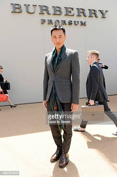 Raymond Lam arrives at Burberry Prorsum SS15 during London Collections Men at Kensington Gardens on June 17 2014 in London England
