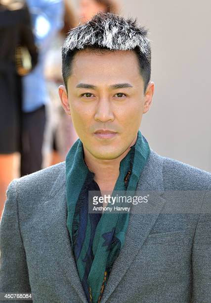 Raymond Lam attends the Burberry Prorsum show during the London Collections Men SS15 on June 17 2014 in London England
