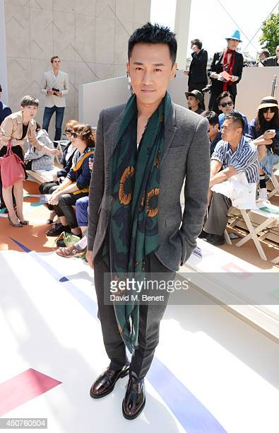 Raymond Lam attends the front row at Burberry Prorsum SS15 during London Collections Men at Kensington Gardens on June 17 2014 in London England