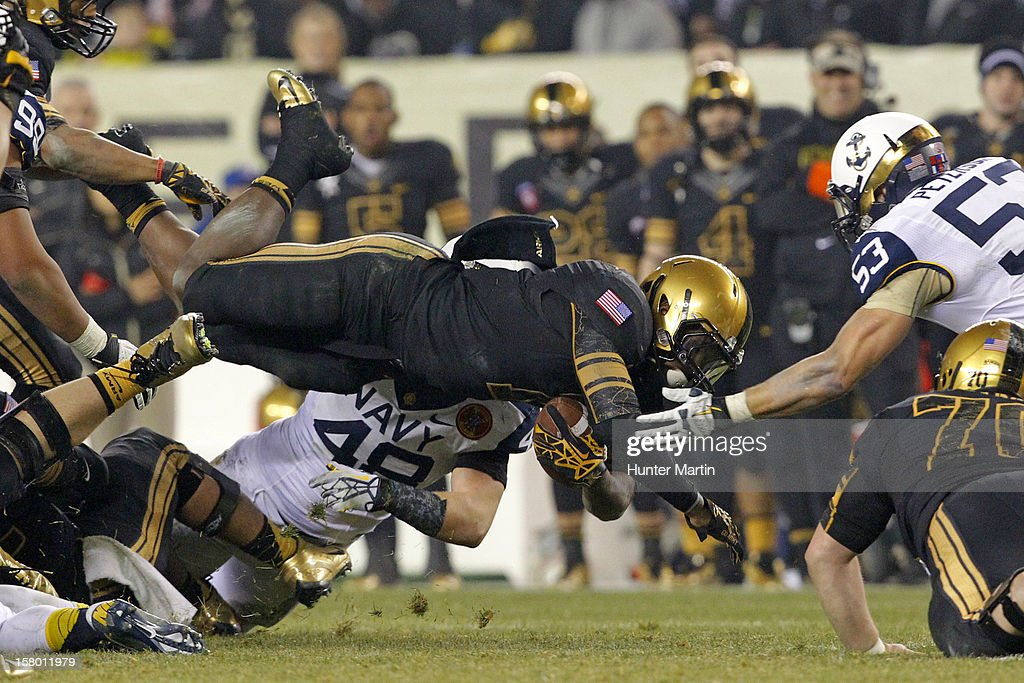 Raymond Maples #1 of the Army Black Knights dives for extra yardage during a game against the Navy Midshipmen on December 8, 2012 at Lincoln Financial Field in Philadelphia, Pennsylvania. The Navy won 17-13.