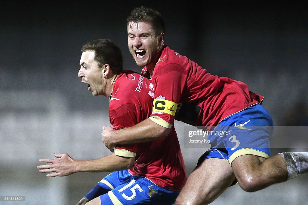 Raymond Miller and captain of the White Eagles, David Vrankovic celebrate a goal during the men's National Premier League match between Bonnrigg and Rockdale at Bonnyrigg Sports Club on May 28, 2016 in Sydney, Australia.