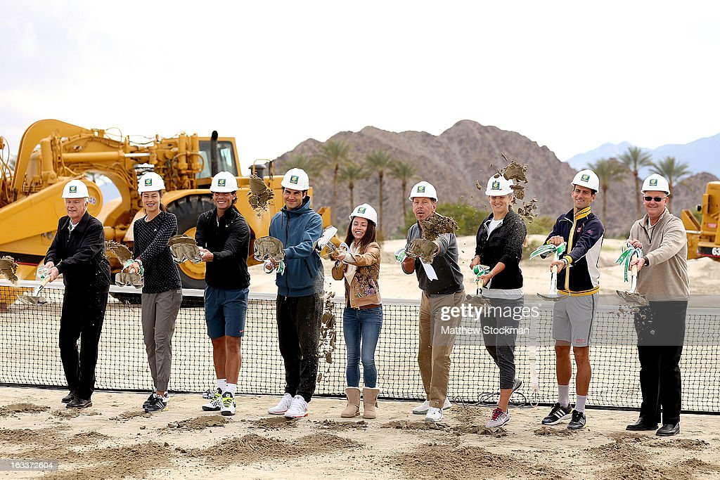 Raymond Moore, Ana Ivanovic of Serbia, Rafael Nadal of Spain, Roger Federer of Switzerland, Nikita Kahn, Larry Ellison, tournament owner and CEO of Oracle, Victoria Azarenka of Belarus, Novak Djokovic of Serbia and Steve Simon participate in a ground breaking for the Indian Wells Tennis Garden expansion during the BNP Paribas Open at the Indian Wells Tennis Garden on March 8, 2013 in Indian Wells, California.