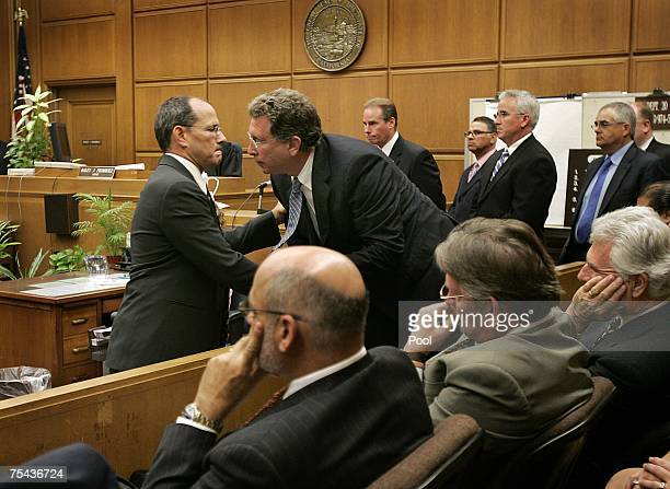 Raymond P Boucher attorney for the alleged abuse victims is congratulated by another attorney sitting in the jury box after his closing statement in...