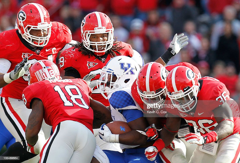 Raymond Sanders of the Kentucky Wildcats is tackled by the Georgia Bulldogs defense at Sanford Stadium on November 19 2011 in Athens Georgia