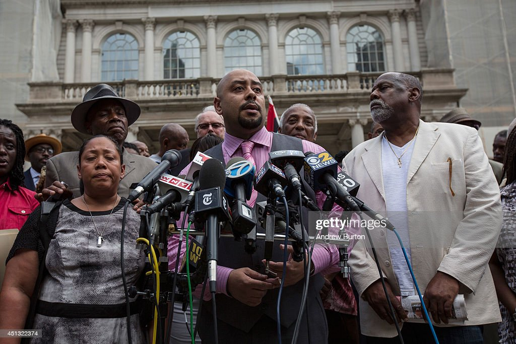 Raymond Santana (C), one of the five men wrongfully convicted of raping a woman in Central Park in 1989, speaks at a press conference on city halls' steps after it was announced that the men, known as the 'Central Park Five,' had settled with New York City for approximately $40 million dollars on June 27, 2014 in New York City. All five men spent time in jail, until their convictions were overturned in 2002 after being proven innocent.