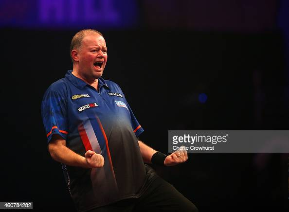Raymond van Barneveld of Holland celebrates winning his first round match against RowbyJohn Rodriguez of Austria during the William Hill PDC World...