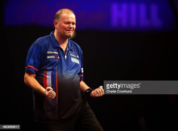 Raymond van Barneveld of Holland celebrates winning his Second round match against Jamie Caven of England during the William Hill PDC World Darts...