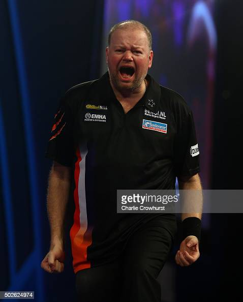 Raymond van Barneveld of Holland celebrates winning his second round match against Stephen Bunting of England during the 2016 William Hill PDC World...