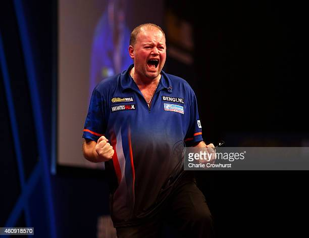 Raymond van Barneveld of Holland celebrates winning his third round match against Adrian Lewis of England during the William Hill PDC World Darts...