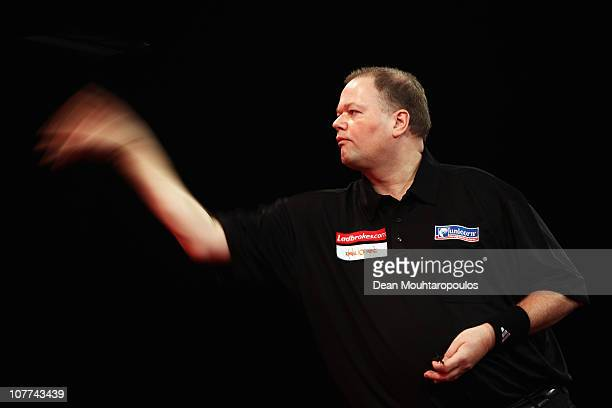 Raymond van Barneveld of Holland in action against Steve Hine of England during day 7 in the 2011 Ladbrokescom World Darts Championship at Alexandra...