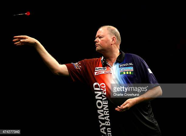 Raymond van Barneveld of Holland in action during his semifinal match against Michael van Gerwen during the Betway Premier League at The 02 Arena on...