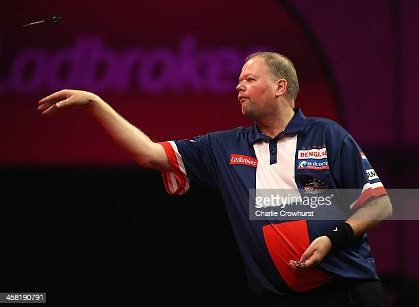 Raymond Van Barneveld of Holland throws during his second round match against Jamie Caven of England during the Ladbrokescom World Darts Championship...
