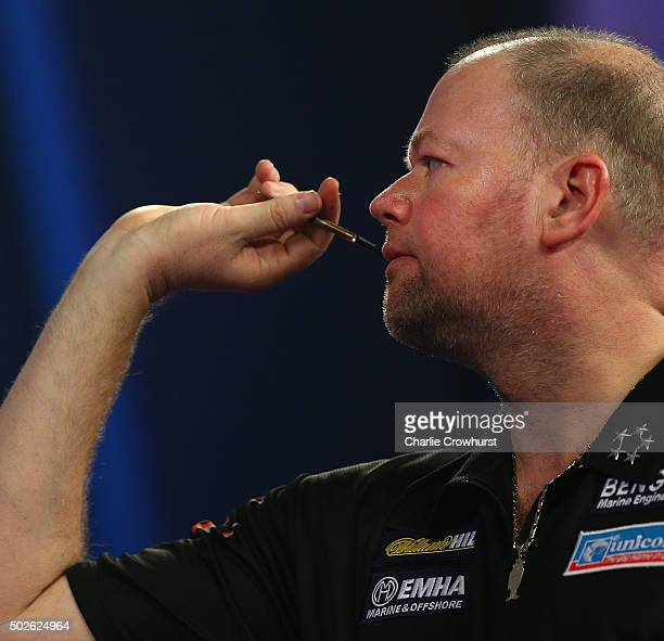 Raymond van Barneveld of Hollandin action during his second round match against Stephen Bunting of England during the 2016 William Hill PDC World...
