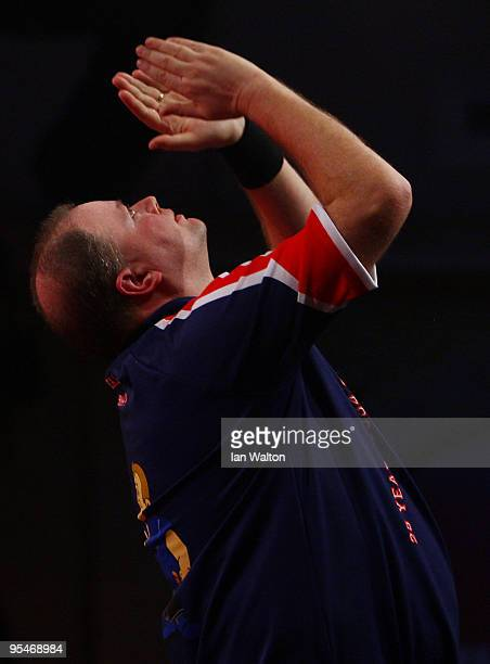 Raymond van Barneveld of Netherlands celebrates winning against Brendan Dolan of Northern Ireland during the 2010 Ladbrokescom World Darts...