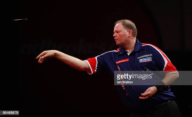 Raymond van Barneveld of Netherlands in action against Brendan Dolan of Northern Ireland during the 2010 Ladbrokescom World Darts Championship Round...