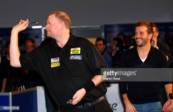 Raymond van Barneveld of Netherlands in action during a dart show tournament at between team Netherlands and Hamburger SV at Imtech Arena on January...