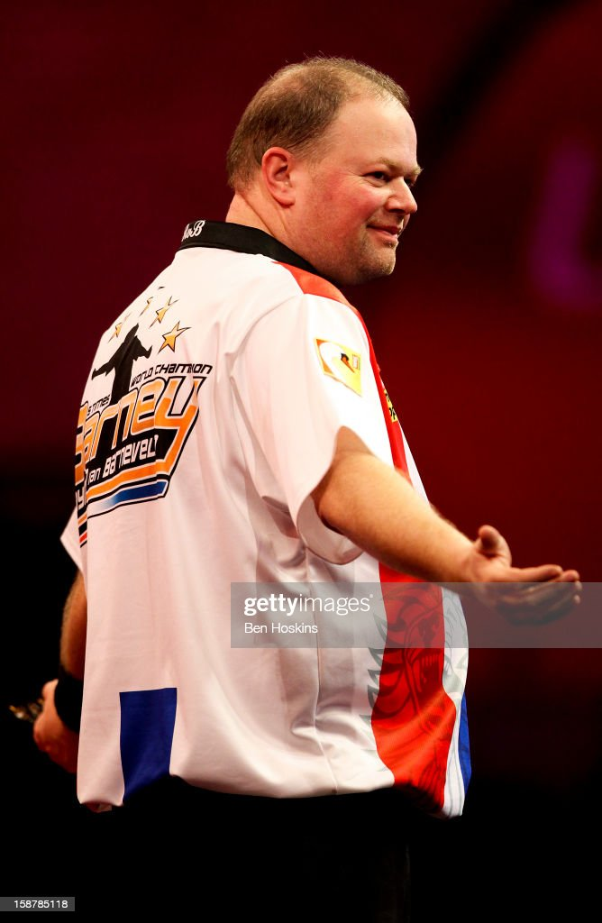 Raymond van Barneveld of the Netherlands celebrates his win during his quarter final match against Simon Whitlock of Australia on day twelve of the 2013 Ladbrokes.com World Darts Championship at the Alexandra Palace on December 28, 2012 in London, England.