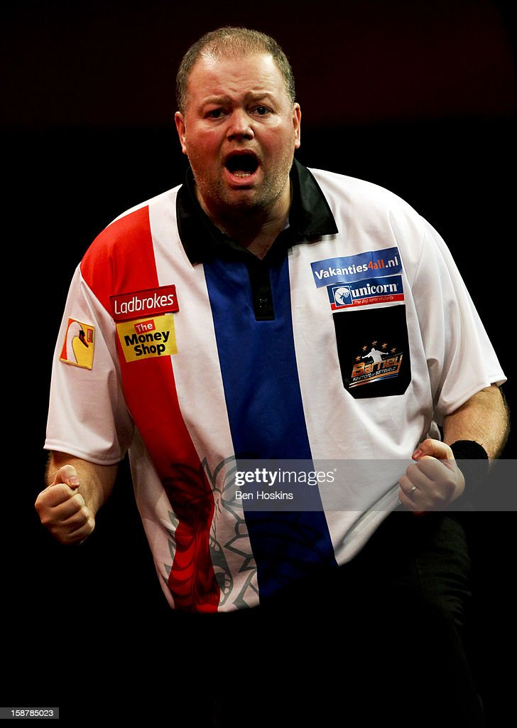 <a gi-track='captionPersonalityLinkClicked' href=/galleries/search?phrase=Raymond+van+Barneveld&family=editorial&specificpeople=2628450 ng-click='$event.stopPropagation()'>Raymond van Barneveld</a> of the Netherlands celebrates taking the first set during his quarter final match against Simon Whitlock of Australia on day twelve of the 2013 Ladbrokes.com World Darts Championship at the Alexandra Palace on December 28, 2012 in London, England.
