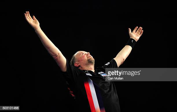 Raymond van Barneveld of the Netherlands celebrates victory over Michael Smith of England in their quarter final match during Day Thirteen of the...
